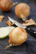 Onions and a knife Stock Photos