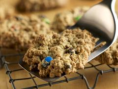 Placing M&M Cookie on a Cooling Rack with a Spatula Stock Photos