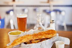 Fried Fish with Chips; Mushy Peas and a Glass of Beer Stock Photos