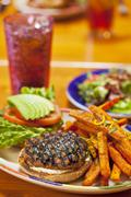 Grilled Turkey Burger with Sweet Potato Fried and a Soda - stock photo
