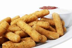 Platter of Fried Mozzarella Sticks with Dipping Sauces - stock photo
