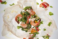 Prawns with vegetables in parchment paper Stock Photos
