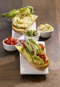 Avocado cream and tomato sandwich Stock Photos