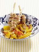 Chicken kebabs with mango salad and cardamom Stock Photos