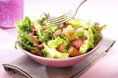 Mixed leaf salad with bacon, tomatoes and croutons - stock photo