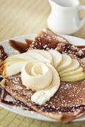 Crepe with Apple Slices, Caramel Sauce and Ice Cream - stock photo
