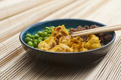 Sanshokudon (rice dish with peas, minced meat and scrambeled egg, Japan) - stock photo