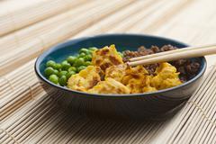 Sanshokudon (rice dish with peas, minced meat and scrambeled egg, Japan) Stock Photos