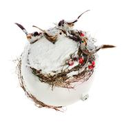 new year's composition from birds, mountain ashes, snow and a white sphere is - stock photo