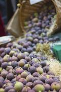 Fresh figs falling from a basket Stock Photos