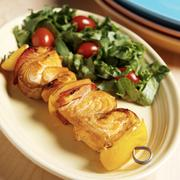 Salmon Kabob Red and Yellow Bell Peppers on a Metal Skewer; Side Salad Stock Photos
