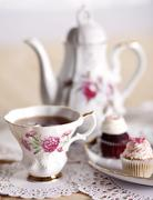 Pretty Antique Tea Cup with Mini Cupcakes and Tea Pot - stock photo