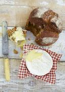 Stock Photo of Bread and warm camembert