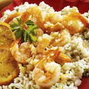 Garlic Sauteed Shrimp on Orange Infused Rice - stock photo
