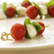 Tomato, Basil and Mozzarella Skewers - stock photo