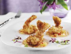 Coconut Crusted Tiger Shrimp with Sweet and Sour Sauce and Micro Greens Stock Photos