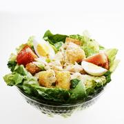 Fast Food Chicken Caesar Salad in a Plastic Container; White Bowl Stock Photos