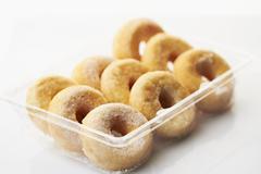 Doughnuts in a plastic box - stock photo
