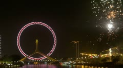 Tianjin Eye fireworks Tianjin China night celebration New Years Eve light party - stock footage