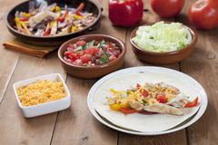 Chicken Fajita on a Plate; Fillings in Background Stock Photos
