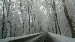 Asphalt road in winter - stock footage