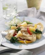 Asian Stir Fried Veggies and Chicken Over Pierogies Stock Photos