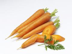 Carrots, whole and chopped - stock photo