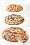 Three Assorted Pizzas; On White Stock Photos