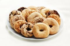 Variety of Bagels on a Platter; White Background - stock photo