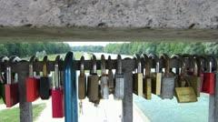 Padlocks locked on bridge as love symbol Stock Footage