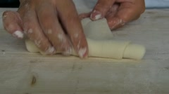 Pastry Croissant rolling making Stock Footage