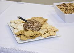 Party cheese ball with crackers Stock Photos