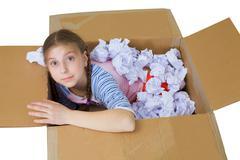 Stock Photo of girl in cardboard box