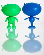 Stock Photo of two figures of aliens on a white