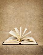 Open big book on a canvas Stock Photos