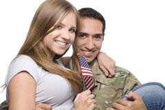 Military Man has Happy Wife in His Arms - stock photo