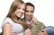 Stock Photo of Military Man has Happy Wife in His Arms