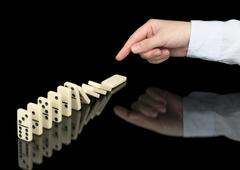 Stock Photo of domino effect in operation