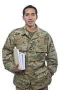 Latino Military Man with School Books - stock photo