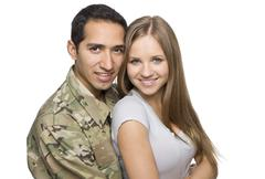 Military Husband and Wife hugging Stock Photos