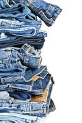 stack of blue jeans over a white background - stock photo
