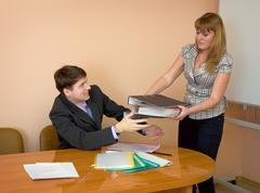 secretary gives a folders to the chief - stock photo