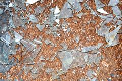 rusty old metal floor and glass - stock photo