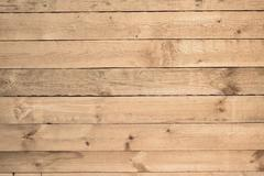 wooden crude uneven wall background - stock photo