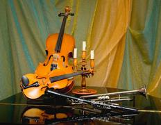 still-life from a violin and other instruments - stock photo