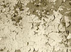 Stock Photo of old damaged paint on a concrete wall - sepia