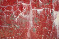 red dirty cracked wall background with stains - stock photo