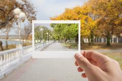 holding instant photo. - stock photo