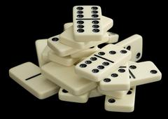 Stock Photo of heap of dominoes on a black background