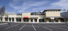upscale strip mall pano - stock photo